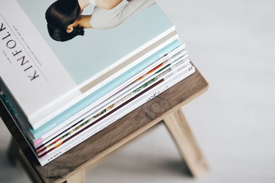 kaboompics_Stack of magazines on the wooden stool