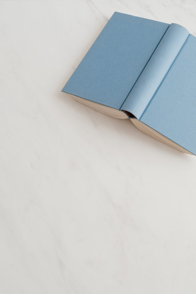 kaboompics_Blue open book on marble table