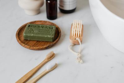 kaboompics_Olive soap - wooden nail brush - bamboo toothbrushes